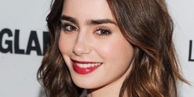 Actress Lily Collins attends the 23rd Annual Glamour Women of the Year Awards hosted by Glamour Magazine at Carnegie Hall on Monday, Nov. 11, 2013 in New York. (Photo by Evan Agostini/Invision/AP)