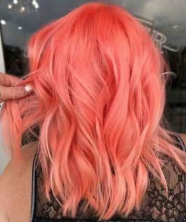 Neon peach hair, la tendenza dell'estate: a chi sta bene e 10 idee da copiare